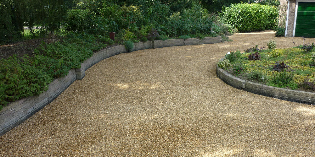 a curved tar and chipping driveway