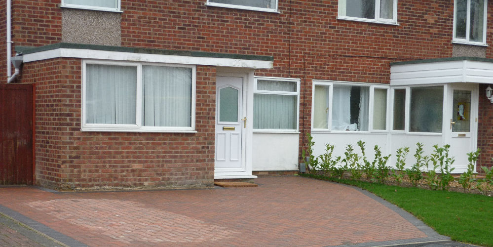 a red block paving driveway