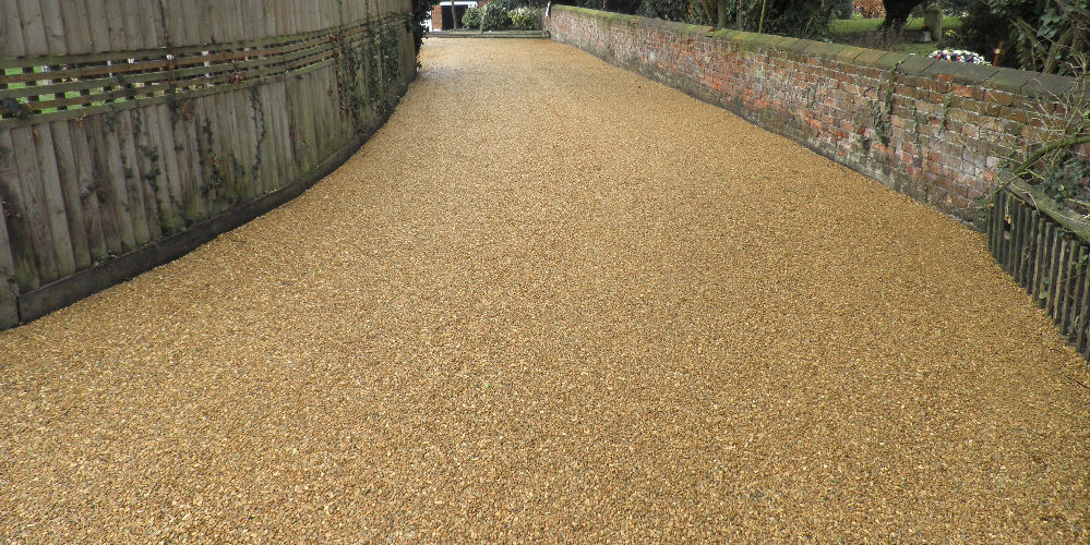 a driveway with newly laid surface dressing
