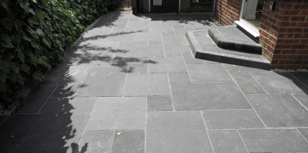 black patio slabs with a step