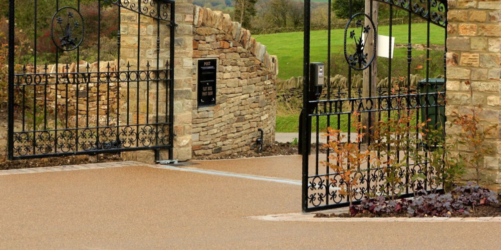 a gated driveway with resin bound surfacing