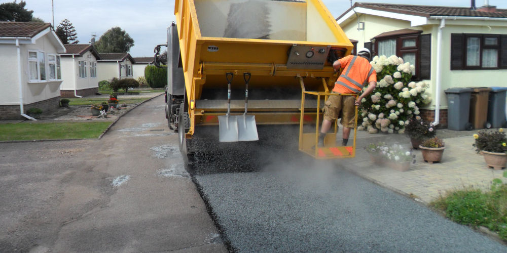 Road surfacing dressing application